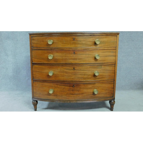 52 - A Regency mahogany bow fronted chest of four long drawers with solid mahogany drawer linings, origin...