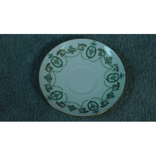 192 - A Minton Adam design complete hand painted dinner service. With swages and foliate design. Gilding t...
