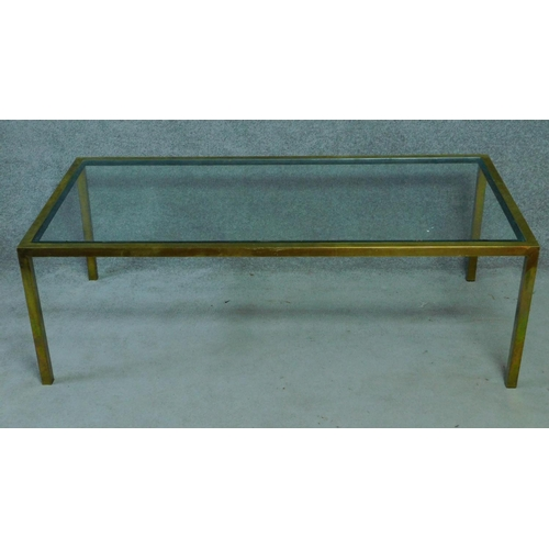 83 - A vintage glass coffee table on brass frame. H.51 W.153 D.77cm...
