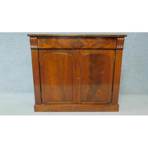 37 - A Regency mahogany chiffonier with panel doors enclosing shelved interior on plinth base. H.90 W.103...