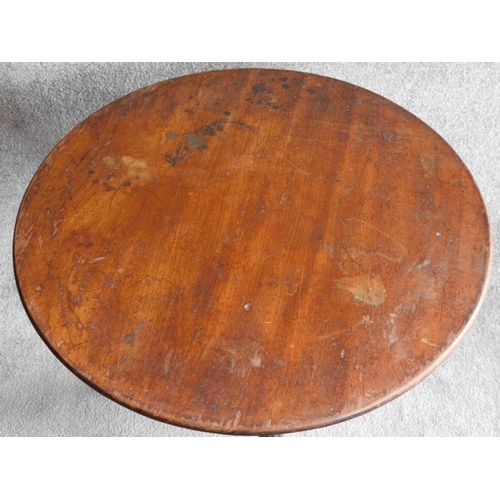 47 - A Georgian mahogany circular tilt top occasional table on well carved tripod cabriole base terminati...