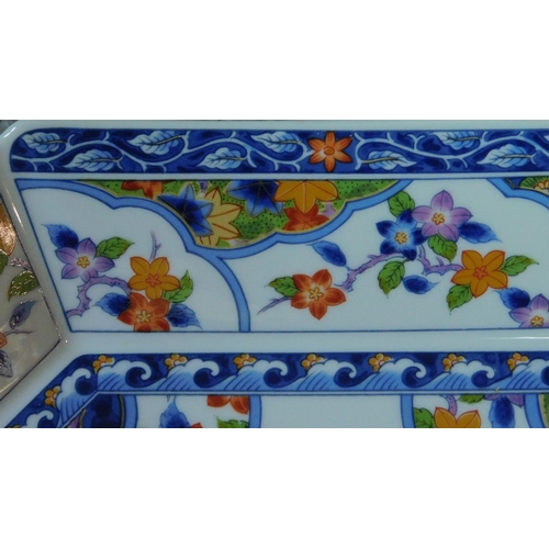 31 - A transfer design oriental handled serving dish. Printed artists seal to base. Decorated with floral...