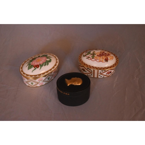 33 - Three bone china and ceramic trinket boxes. Two by Royal Crown Derby, Wild Rose and Honeysuckle desi...