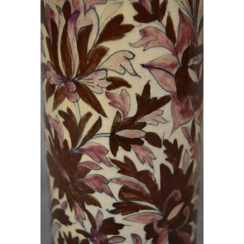 34 - A Persian Isfahan bamboo vase, decorated with stylised flowers. H.70cm