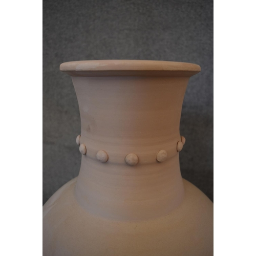 35 - A large pair of Persian Hamadan storage pots with studded collars. H.85 x 50cm