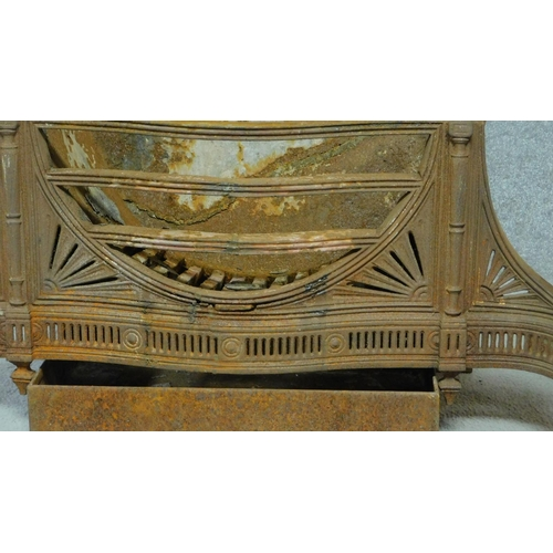 50 - A large Regency steel fire basket with pierced decoration and classical style brass andirons. H.90 W...