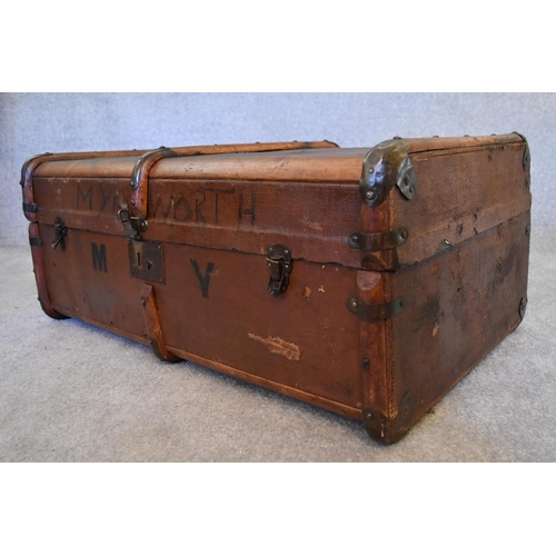 81 - A vintage canvas and beechwood bound steamer trunk. H.37 x 80cm
