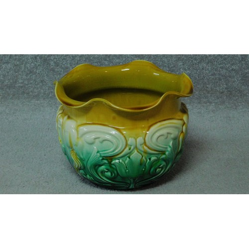 36 - Two painted green ceramic miniature jardineres on column stands and an Art Nouveau floral design gla...