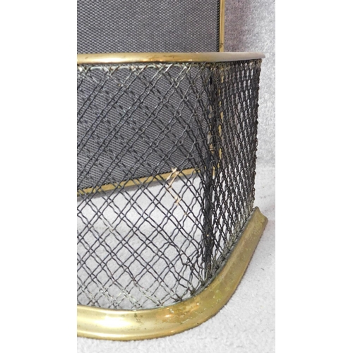 56 - An antique brass mesh fender and brass hinged spark guard with carrying handle. H.82xW.122cm