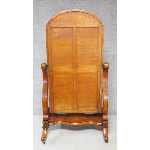 96 - A Victorian mahogany cheval mirror with arched swing plate supported by platform cabriole base. H.16...