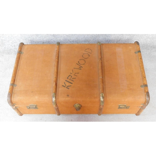 58 - A teak bound and canvas covered Kirkwood travelling trunk fitted with lift out tray. H.30xW.90xD.50c...