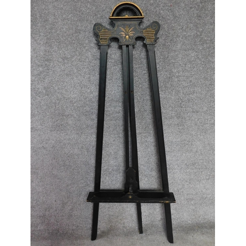 60 - A late Victorian ebonised easel with gilt detailing. H.146cm...