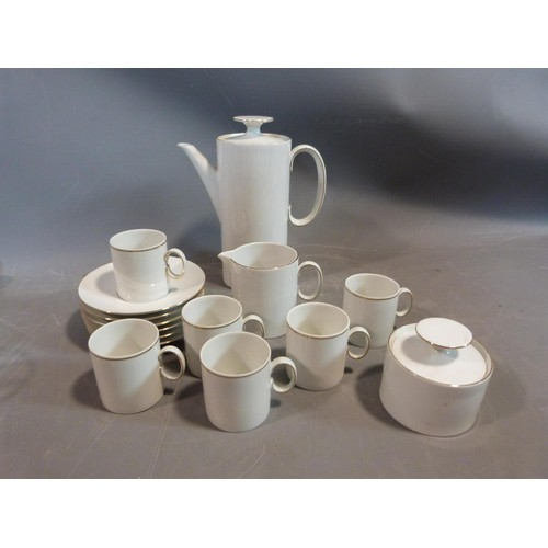 17 - A white porcelain Thomas Germany gilded coffee set. H 22.5cm....