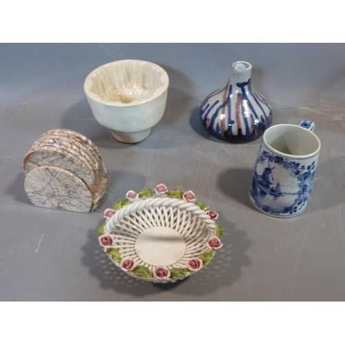 21 - A collection of studio pottery. Including an antique ceramic jelly mould, woven Italian ceramic bask...