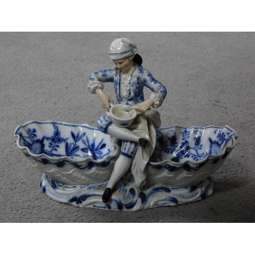 24 - A pair of meissen blue onion pattern porcelain sweet meat dishes. One of a lady and one of a cross l...