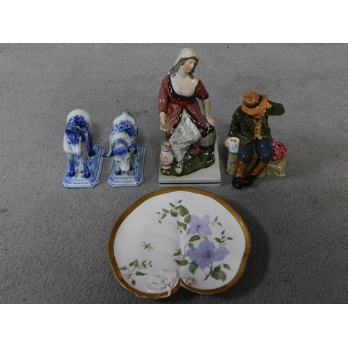 26 - A collection of porcelain figures and a plate. A Royal Doulton 'Owd William' figure, an early hand p...