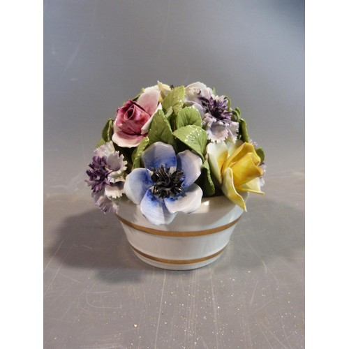 27 - A collection of porcelain Lladro figures and ornaments. Including two porcelain flower baskets one b...