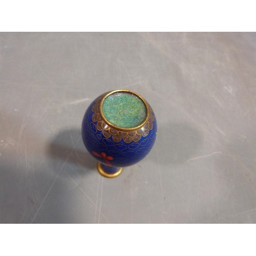 37 - A Chinese Cloisonné enamel vase. With peony and butterfly motifs and a cloud form background. H10cm....