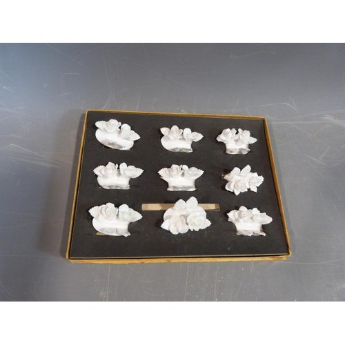 28 - A collection of boxed Coalport and Royal Staffordshire white porcelain floral menu holders. H5cm....