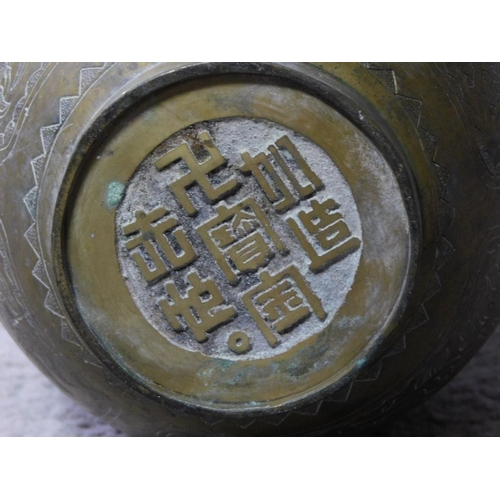 48 - A pair of brass Chinese vases with engraved design depicting clouds, flowers, lucky bats and butterf...