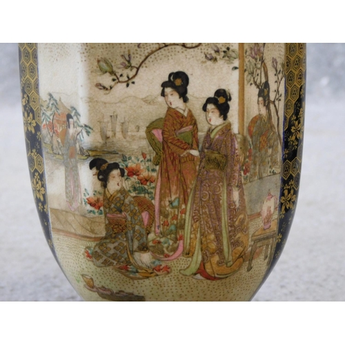 29 - A pair of satsuma pottery Japanese vases with hand painted and gilded figures and floral design. Art...