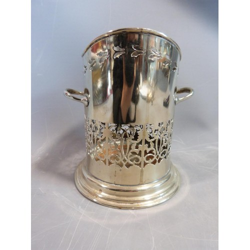 9 - A collection of silver plate items. Including an antique razor ,a pierced two handled wine bottle ho...