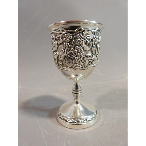 10 - A set of six white metal silea vine design kiddush cups. H.8cm.