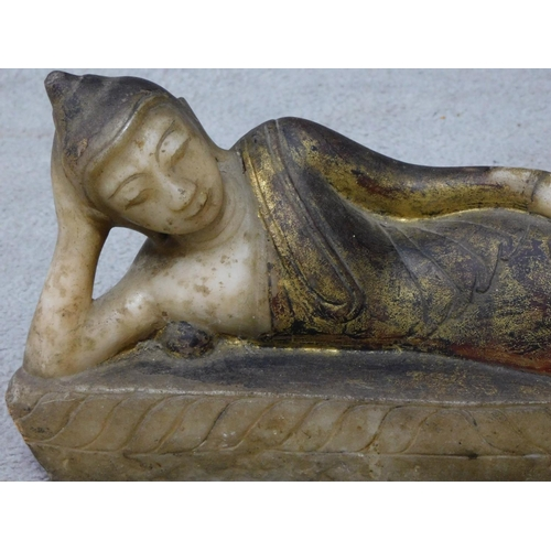 53 - An antique painted, lacquer and gilded alabaster Burmese lying buddah sculpture. H.19 W.45cm...