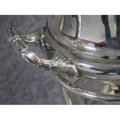 11 - A silver plated campana form wine cooler on standby Barker Ellis. Vine details to the handles. H.82...