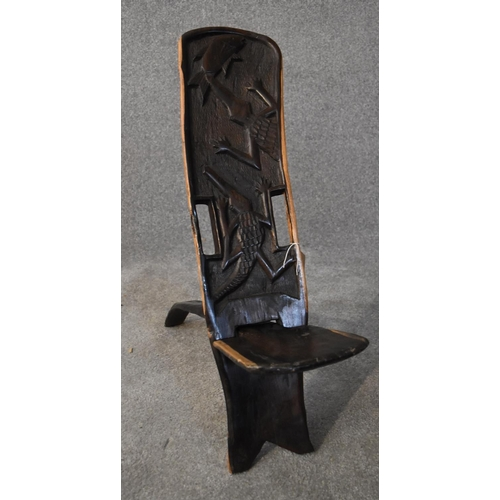 203 - An African carved hardwood two part palaver chair with relief alligator detailing. H.80x20cm...