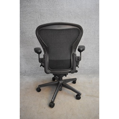 46 - A contemporary Herman Miller Aeron ergonomic design office chair with reclining, swivelling and up a...