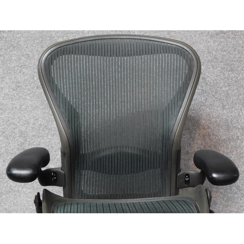 47 - A contemporary Herman Miller Aeron ergonomic design office chair with reclining, swivelling and up a...