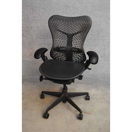 50 - A contemporary Herman Miller Mirra ergonomic design office chair with reclining, swivelling and up a...