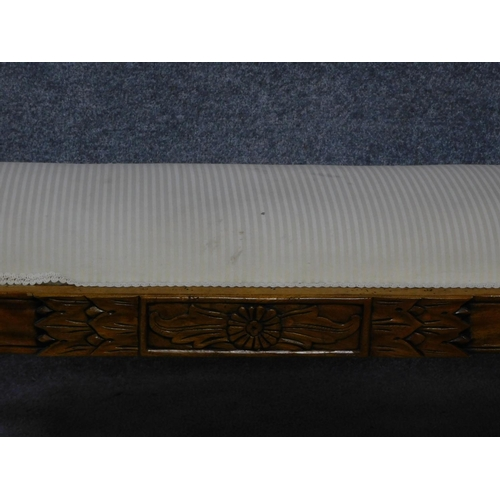 169 - A Regency style mahogany window seat on swept supports. H.65 W.165 D.48cm...