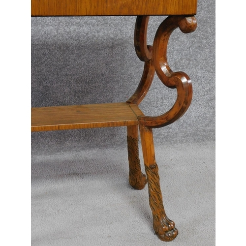 170 - A 19th century Continental ebony line inlaid lamp table on shaped cabriole lion paw supports. H.69 L...