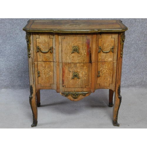 171 - A 19th century Continental walnut two drawer commode with ormolu edges and mounts and allover satinw...