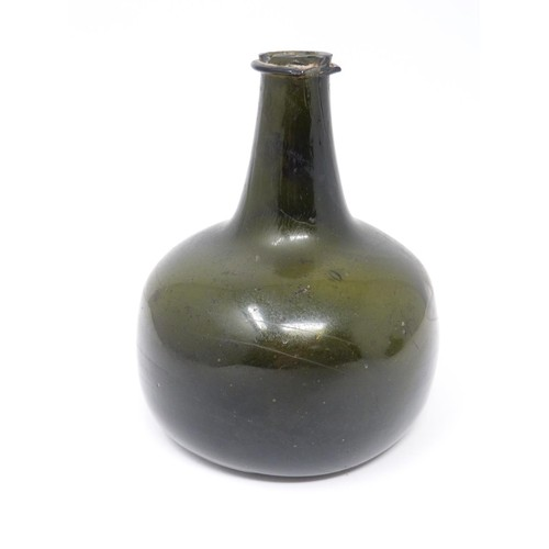 35 - Two 17th to early 18th century green glass onion shaped wine bottles....