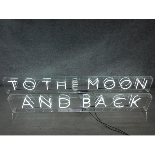 64 - Two neon tube light up signs cased in perspex. H.45 W.260 D.24cm (Largest)...