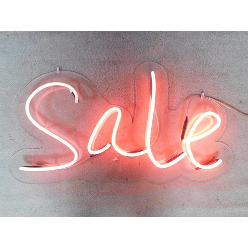 65 - A neon tube wall mounted light up sign. (light doesnt stay on). 60x111cm...
