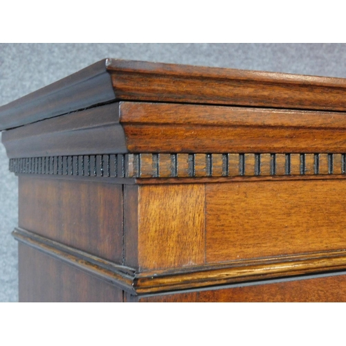 137 - A Georgian style mahogany narrow library bookcase with glazed upper section above base drawer on pli...