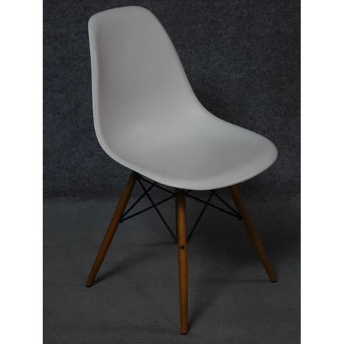 138 - A pair of Eames Vitra dining chairs and a similar chair. H.82cm...