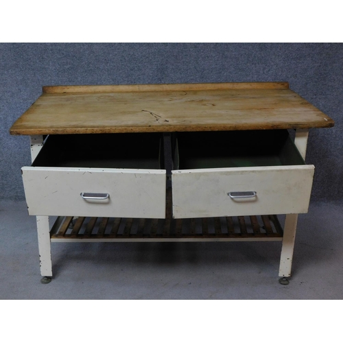 139 - A vintage pine topped and metal framed kitchen side table fitted with two frieze drawers on square s...