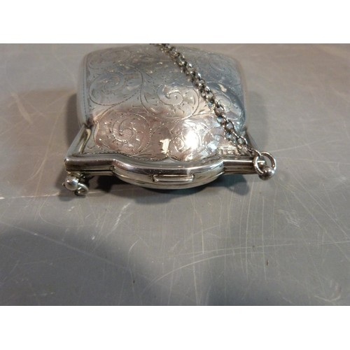 3 - An Edwardian sterling silver ladies coin purse suspended from chain. It has scrolling engraved flora...
