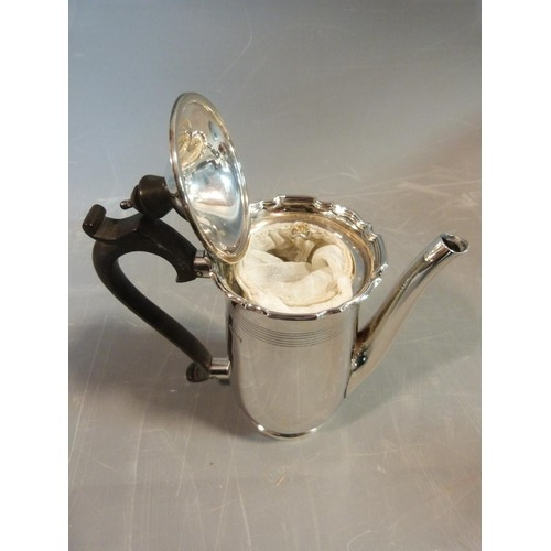 4 - A pair of sterling silver cafe au lait pots by Walker & Hall. Hallmarked, Sheffield, 1949. With line...