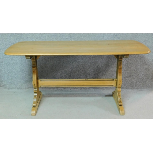 275 - A vintage elm dining table with planked and pegged top on stretchered trestle supports. H.71 W.153 D...