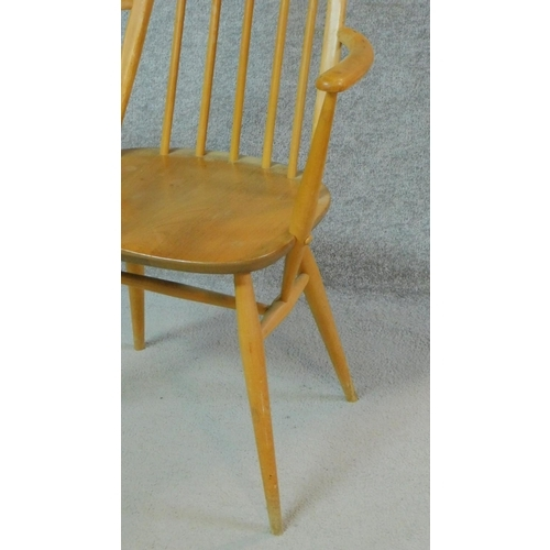 277 - A pair of vintage beech framed Ercol Quaker Windsor armchairs with elm seats. H.96cm...