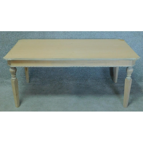 278 - A Louis XVI style painted pine coffee table on square tapering fluted supports. H.52 W.120 D.70cm...