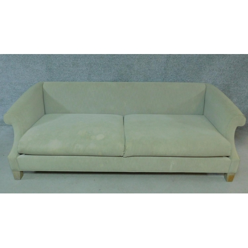 252 - A contemporary scroll arm sofa in beige upholstery on block feet. H.67 W.220 D.100cm...