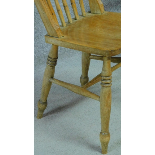 327 - A pair of rustic elm dining chair on turned stretchered supports together with a similar example. H....