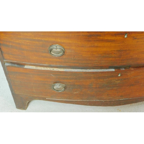 273 - A Georgian mahogany and satinwood crossbanded bowfronted chest of two short over three long drawers ...